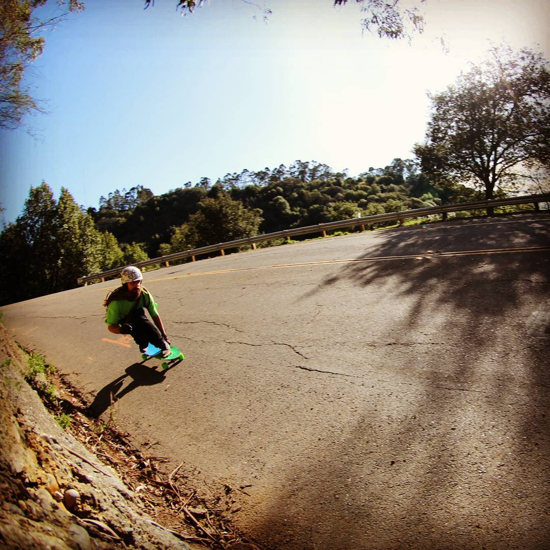 Team rider Adrian Da Kine--@adrian_da_kine coming through a right in the Oakland hills on the MC Cat board!