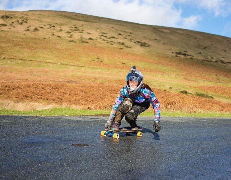 @longboard_girls_crew_uk rider @skatencats during a surprisingly wet (ha!) run in UK. Yas Hermione! @lightphonics photo.  #longboardgirlscrew #womensupportingwomen #skatelikeagirl #lgcuk #hermionesimpson #downhillskateboarding #wetruns