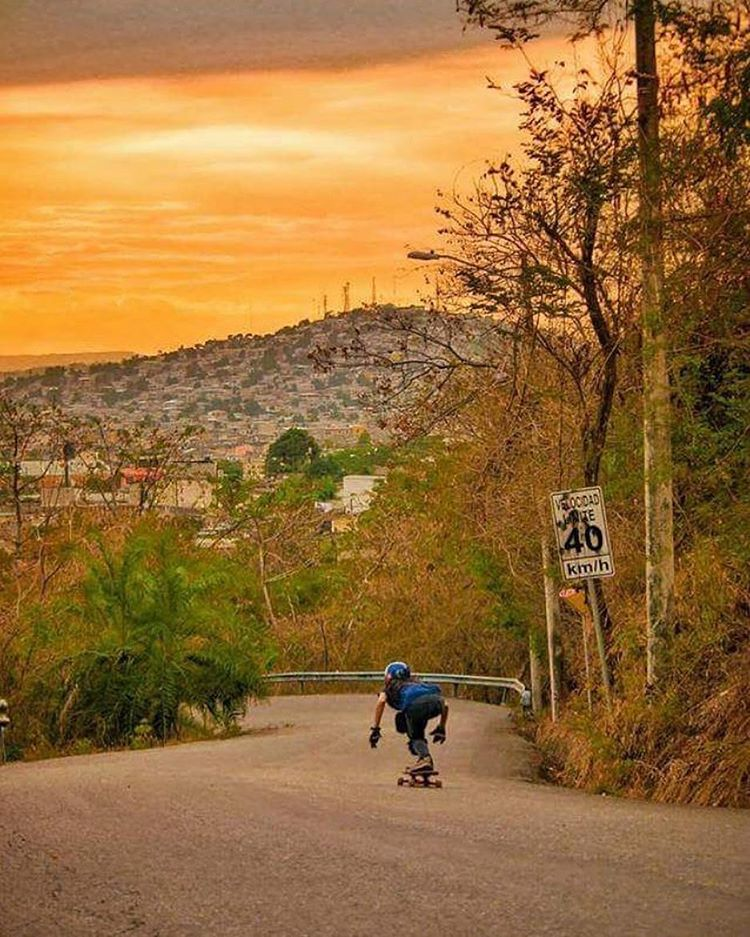 LGC Ecuador @longboardgirlscrewec Rider @andiimartinez about to turn left in what seems to be the most epic Ecuadorian sunset. Wow! Photo cred @danielzevallos12  #longboardgirlscrew #womensupportingwomen #skatelikeagirl #lgcecuador #andreamartinez #lgc...