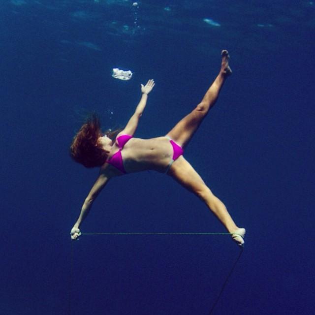 @swellliving in the soon to be released @odinasurf hot pink bikini! #underwateryoga #underthesea #sarahleephoto #pinkbikini