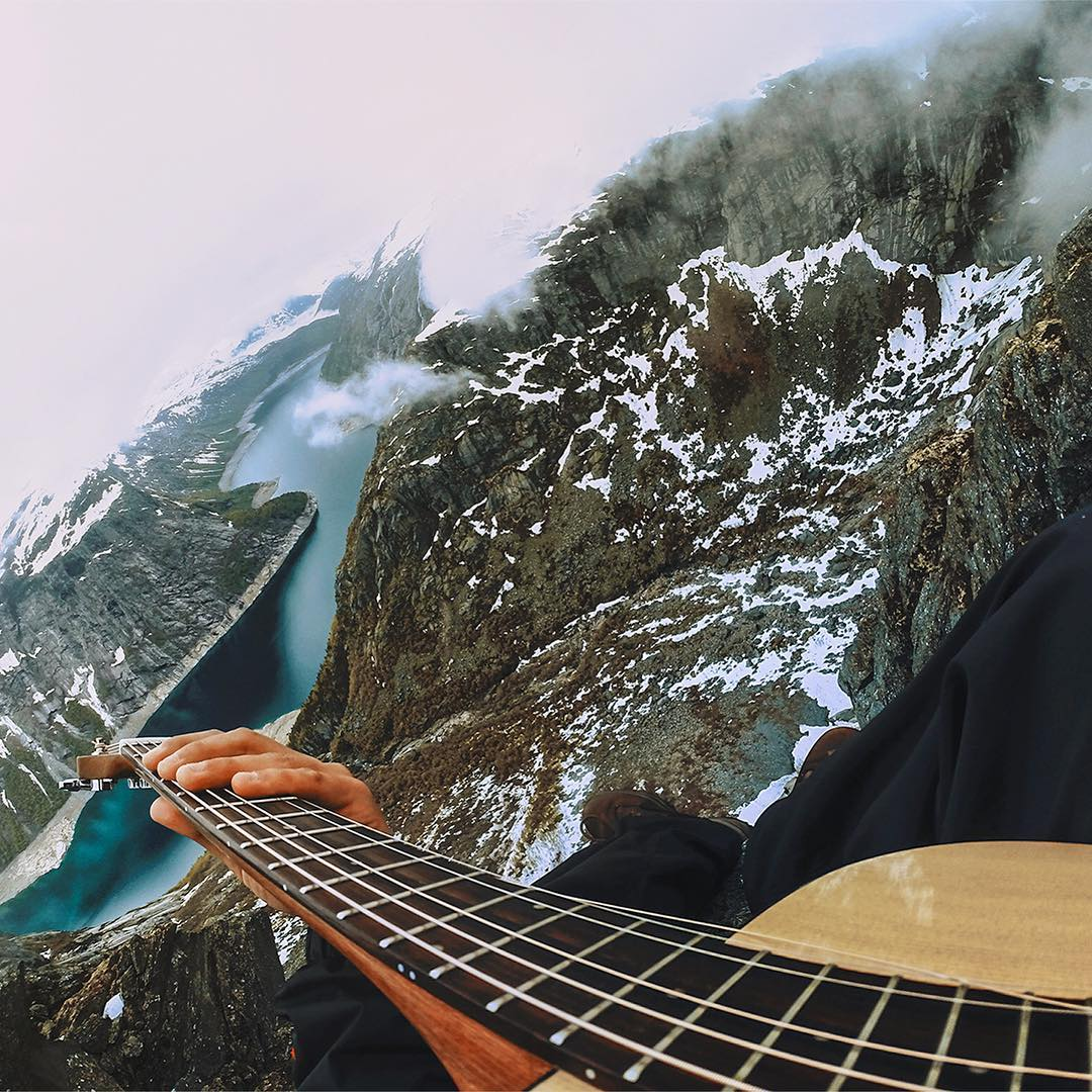 It's a long way to the top...if you wanna to rock 'n' roll!! @the.traveling.guitarist proved that by trekking up the #trolltunga to rock out. #GoPro #GoProMusic #