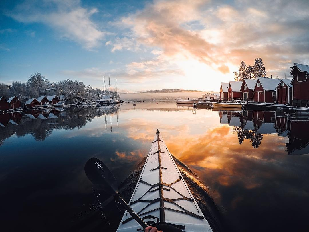 Photo of the Day! @tfbergen soaks in the first rays of sunlight at #dawn on the water in #Norway. How are you starting your day? Share with us via link in our bio. #GoPro #Kayak