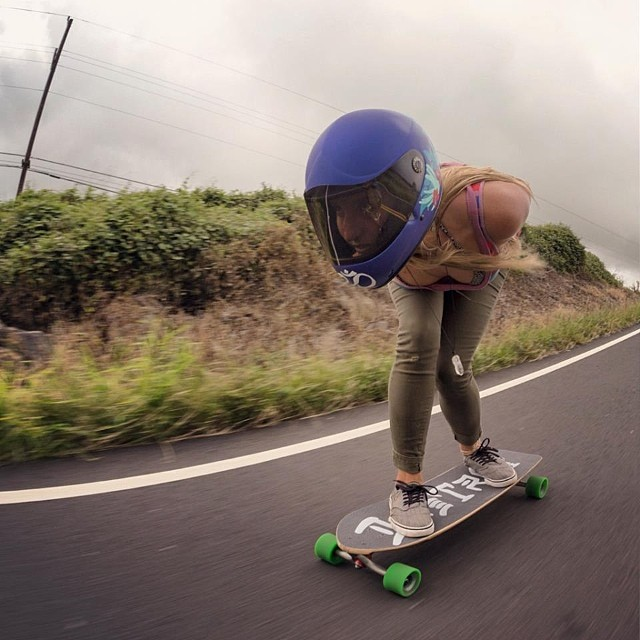 Emma Daigle @manolitamade doing her thang in #Hawaii. @mattkienzle snap #longboardgirlscrew