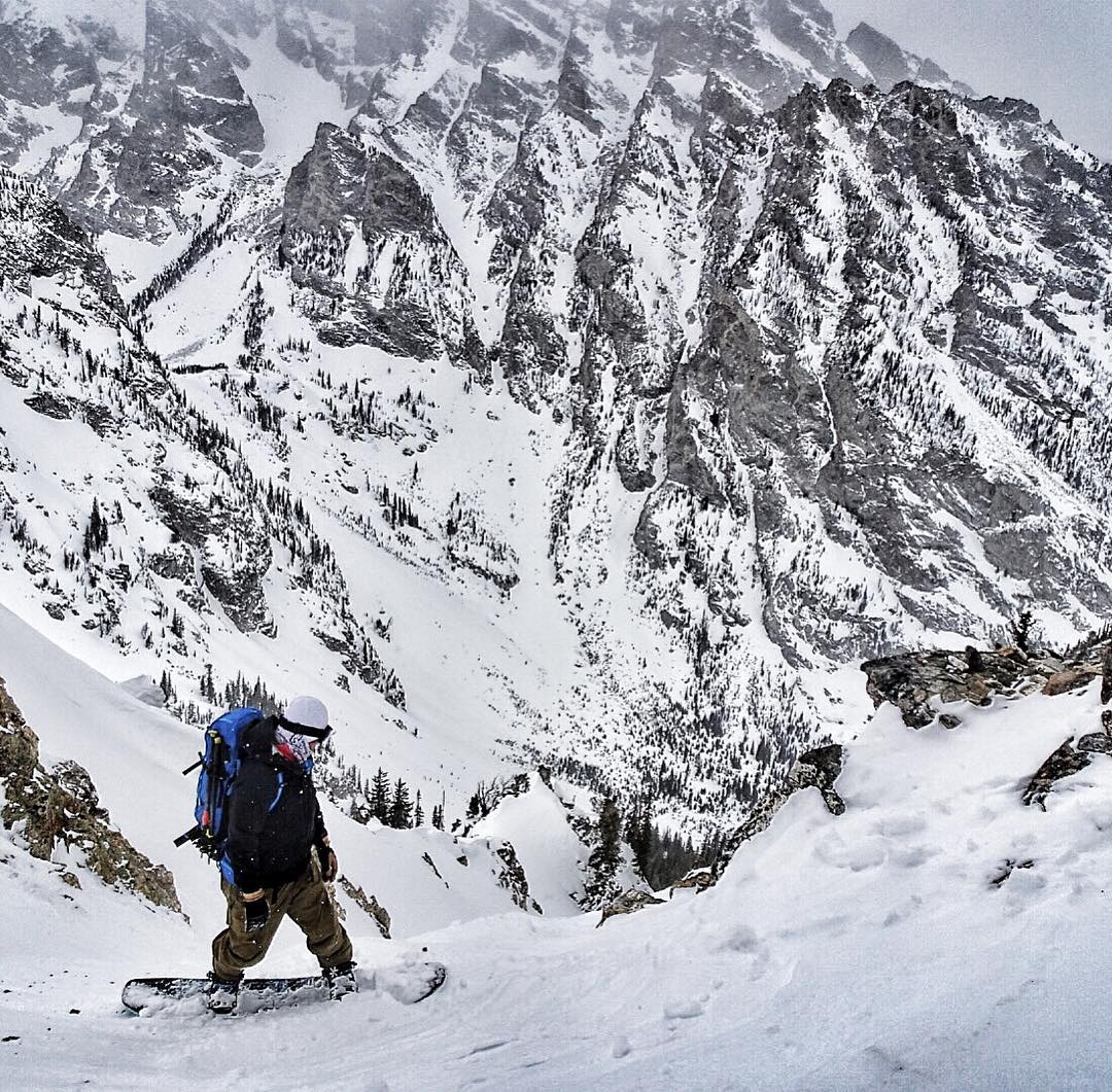 @tetonsplitboarder checking his line down Turkey Chute in the Tetons today.  Mellow split up 3200 vertical feet to the top of the drop in, and it was pow the whole way down!  #avalon7 #liveactivated #snowboarding #followthestoke #splitboarding #jhlife...
