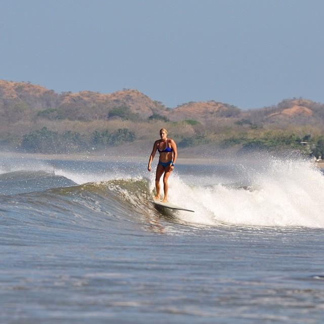 @sambatothesea logging on a Tamarindo Rivermouth peeler and rocking Mi Ola #costarica #puravida #tamarindo #miola #sexybikinisthatstayon #surferbabe