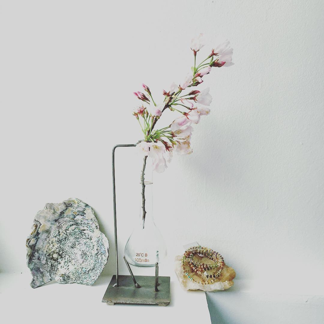 The Studio view today.  Prepping orders, working on new ideas and of course, playing with flowers, Crystal and seashells.  Sometimes I think I may take myself way too seriously :) #artiststudio #designspiration #blooming #seashells #crystals...