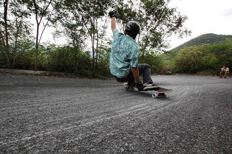 @levipurple with the low low grabs.  Photo by @longboardmexicostore #divinewheelco #divinewheels #divineberserkers