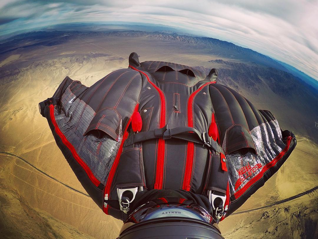 @savagesac enjoying a laid-back view at 12,000 feet. GoPro HERO4 | GoPole Arm #gopro #gopole #gopolearm #skydiving #wingsuit