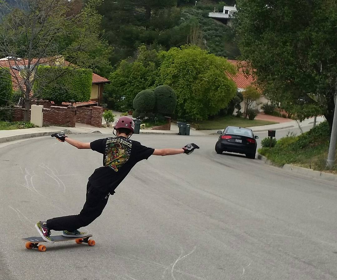 @johnny_bfc sliding his way down the hill with some fresh gear.  Photo by Rick James #divinewheelco #divinewheels #divinestreetslayers #restlesswim