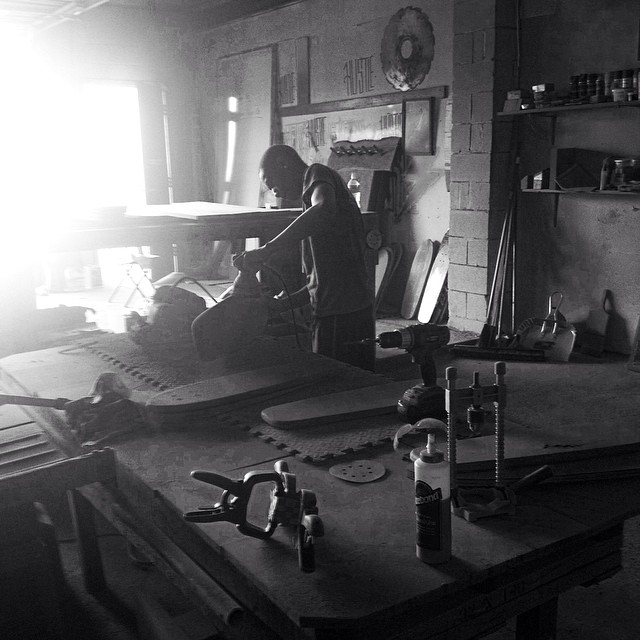 Kendrice in the shop early this morning shaping some boards.