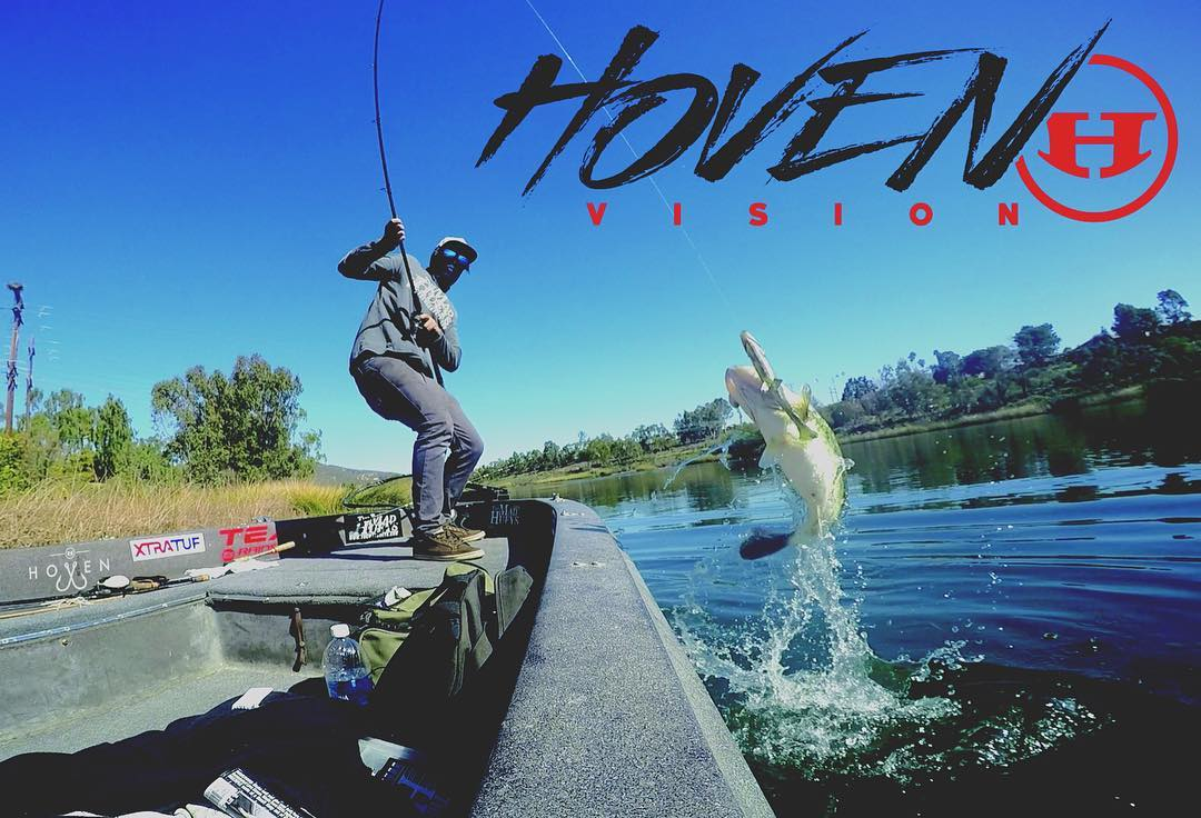 Team Hoven waterman @jay_saberon in action catching some fatty Cali bass.  He is wearing our best wrap style sunglass called, The Meal Ticket. This polarized pair floats and is available at www.hovenvision.com.  #alwayssunblockingneverfunblocking...