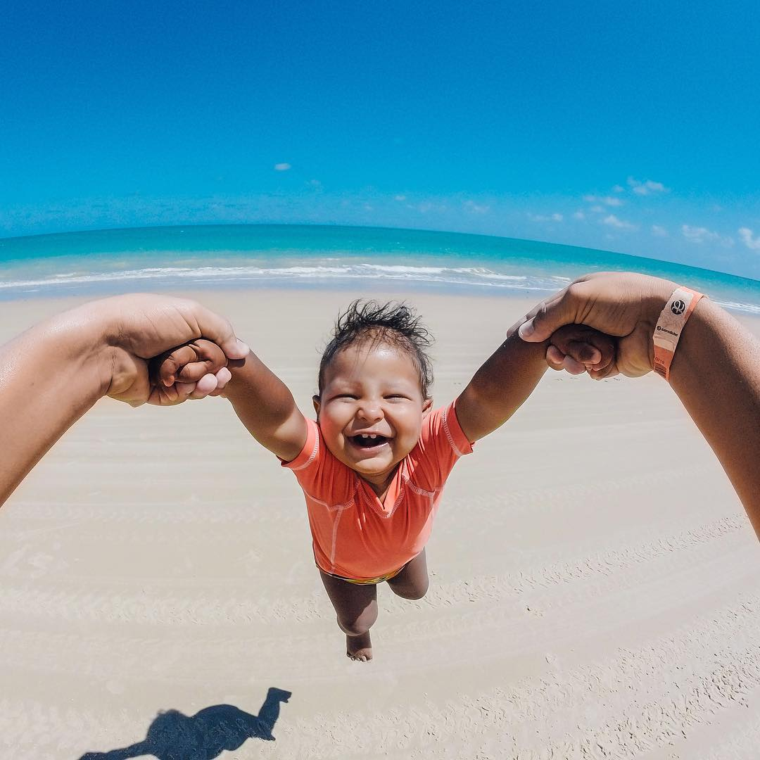 Photo of the Day! Weeeeeeeeeeeeeeeeeee! @brunoamendes shares his nephew's smile that's as big and beautiful as the beaches of #Brazil!  Show us your  #FamilyTime via link in our bio #GoPro #
