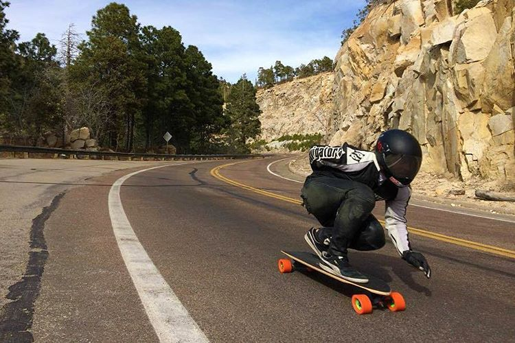 @jasonbither charging on the Penrose through Arizona. (Photo by @andresaz) #dblongboards #dbpenrose #downhillskateboarding #longboard #longboarding