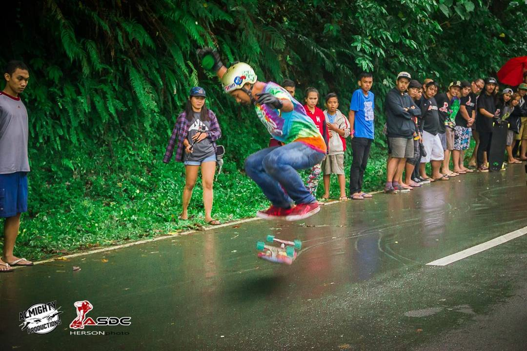 Zul owning best trick at Asian Sampaloc Downhill Competition Slide Jam with this slick heelside to kickflip