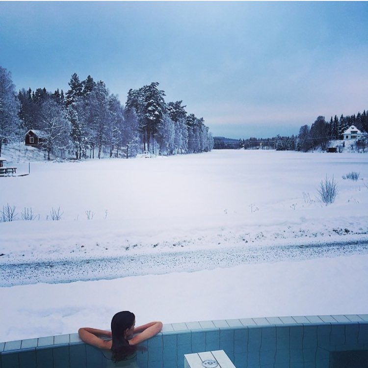 @ekericsson repping KF in a wintery Sweden. Not pictured: Elin running around in that field, drawing hot dogs in the snow. Never too cold for a bikini. #winterswim #kindasnowy