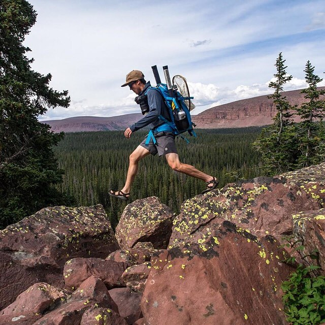 Nathan from @outsmartingfish and @wildrootsoutdoors skipping across boulders in Utah's Uinta Mountains. Found himself some wild raspberries out there, which you can see in the lower right corner.  Photo by @wildrootsoutdoors. #peakdesign #findyourpeak...