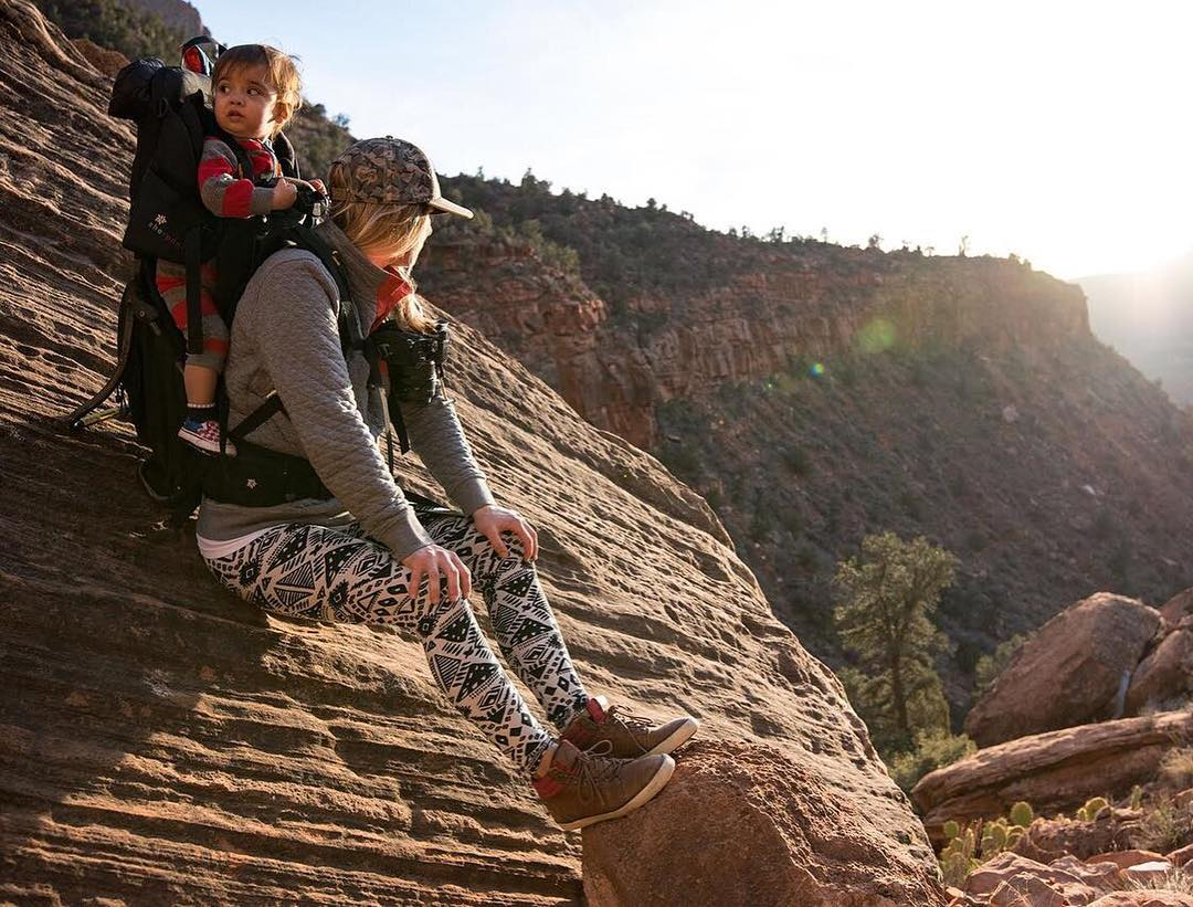 Candace of @outsmartingfish and @wildrootsoutdoors chillin' in Zion, tiny friend in tow.  Photo by @wildrootsoutdoors. #captureclip #capturepro #zion #sunset #peakdesign #findyourpeak
