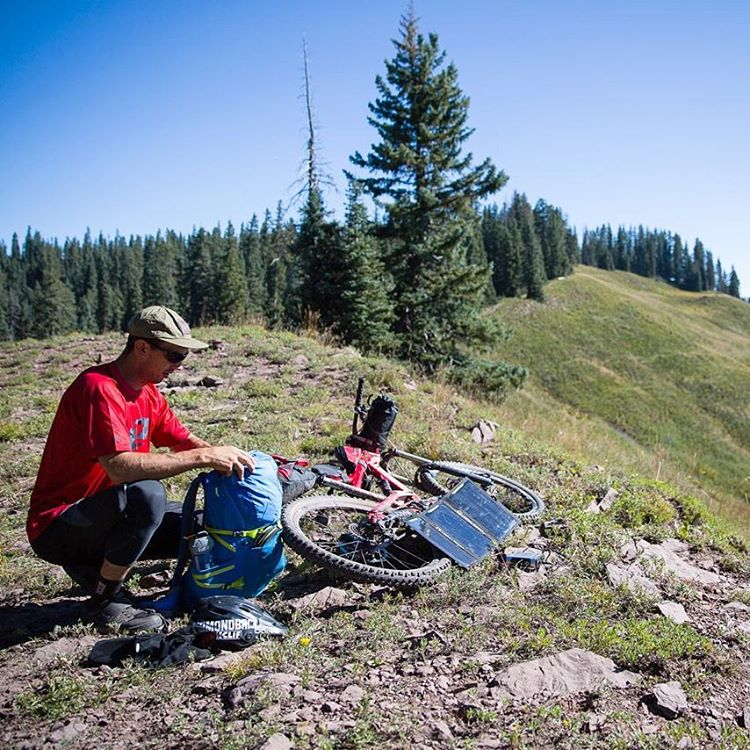 """Packing up camp here on day 4, at about 10,500 feet. We're about to cross from the San Juan mountains over to the La Plata mountains, and then we'll have one more day of riding to make it back to Durango. Using the panels to charge GPS, GoPros, and..."