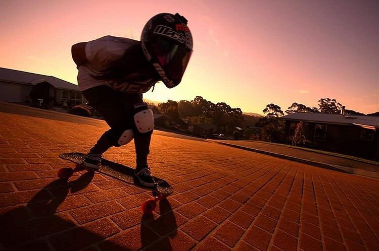 LGC Australia rider @the_forbidden_jutsu skating down a rocky ground. The sunset ain't bad either. @jaydencook100 photo.  Use the #longboardgirlscrew so we can find tour photos!