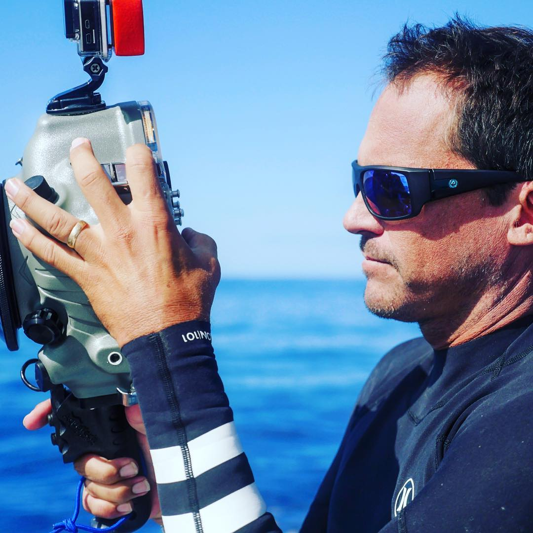 Camera check before jumping in with some of the scariest sharks on earth. Another day at the office for @clarklittle sporting his new signature Clark Little Vantage sunglass debuting this spring. See more at dragonalliance.com. #happyfriday...