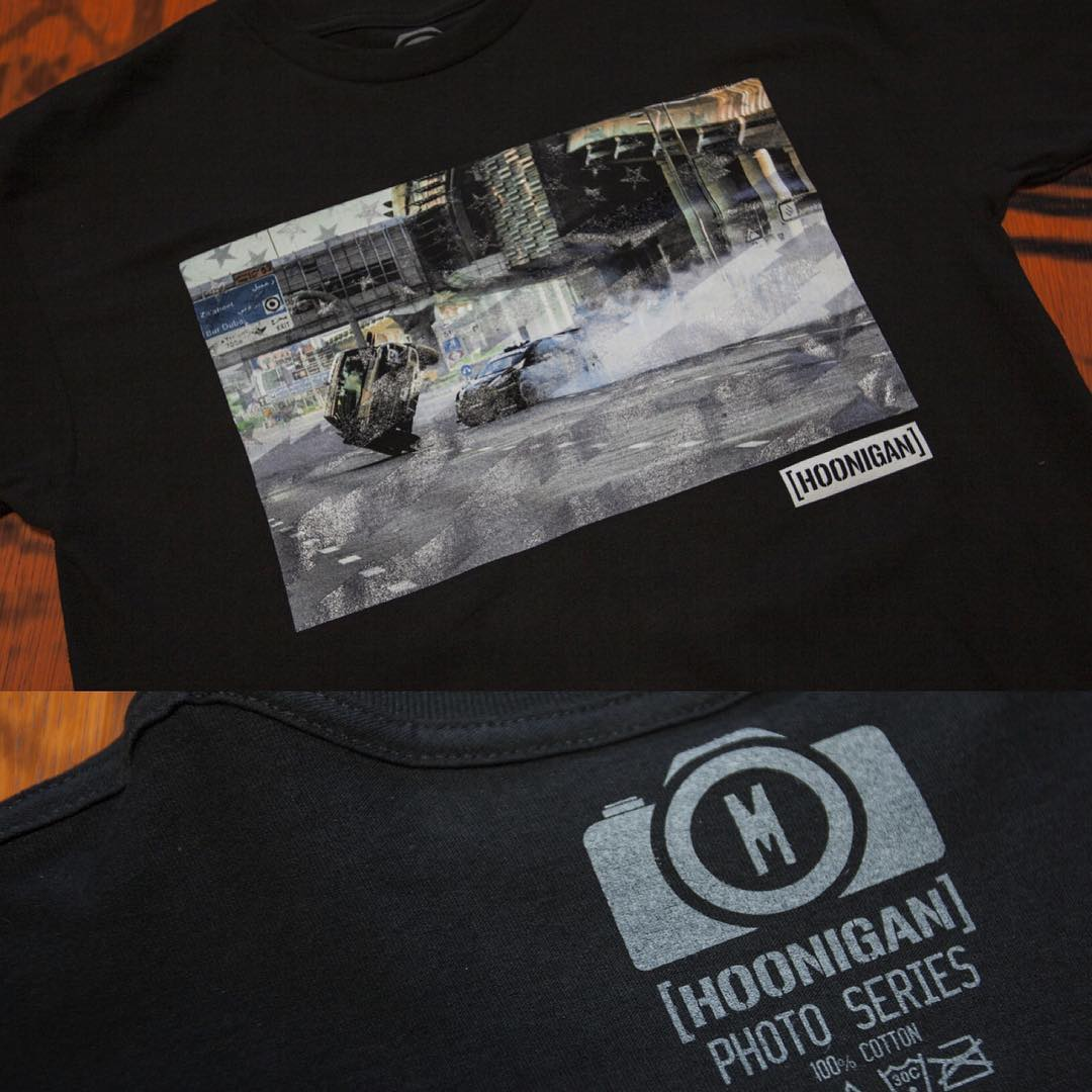 Details of our #GymkhanaEIGHT photo tee. One of the raddest scenes, when @kblock43 pilots his RX43 around a Raptor driving on 2 wheels, printed behind our Stars & Stripes pattern. Even the tagless print is pretty rad. Get yours on #hooniganDOTcom.