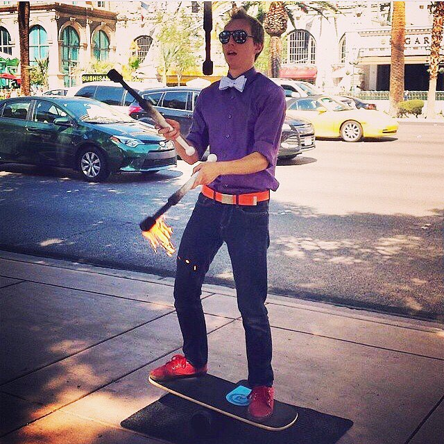 Torch juggling on a balance board? Now that's awesome.