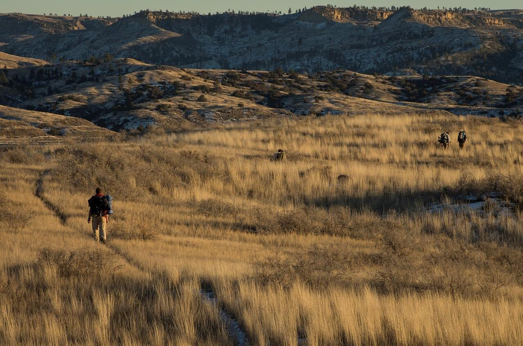 The #ASCLandmark crew following #wildlife trails to scout new remote camera locations on an overnight trip in Montana's #MissouriBreaks.  Photo: @eli.allan.photography #montanamoment #adventurescience #prairie #tbt