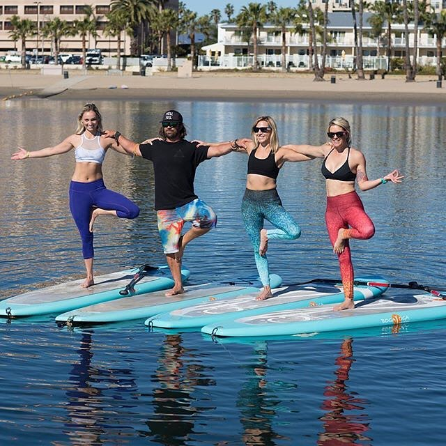 "AQUA YOGA #repost @oceanyogi6 & @yogaqua ""I get by with a little help from my friends"" #beatles"