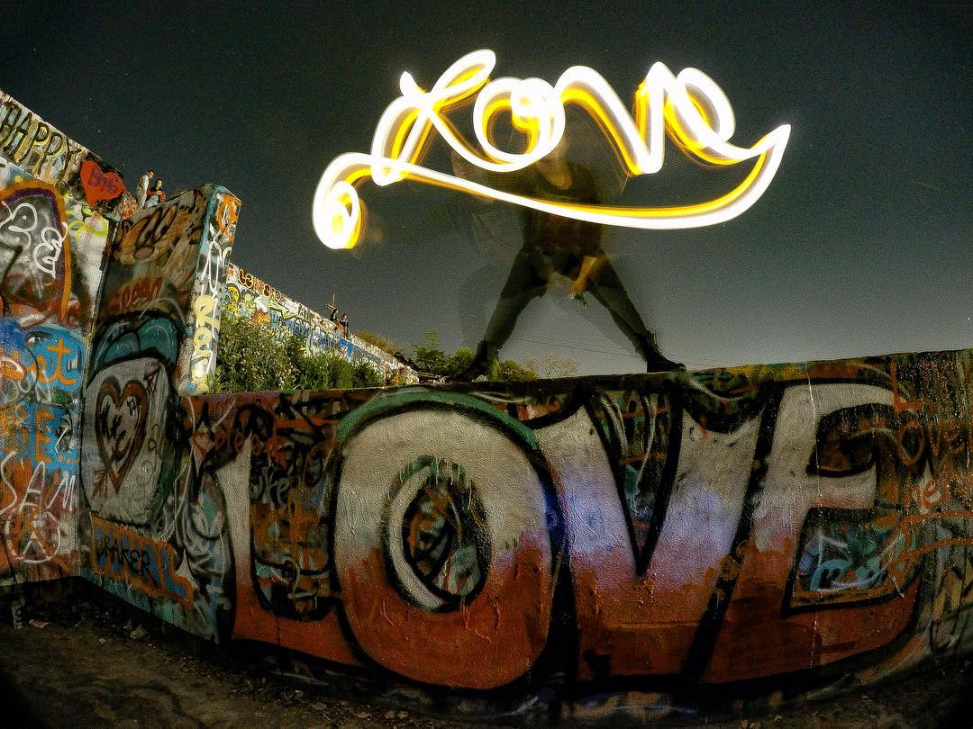 @songsaboutjenny light painting at the Hope Outdoor Gallery. • • Photo by @gopro_ajax • • #love #graffiti #grafite #streetart #austintx #texas #tx #spratx