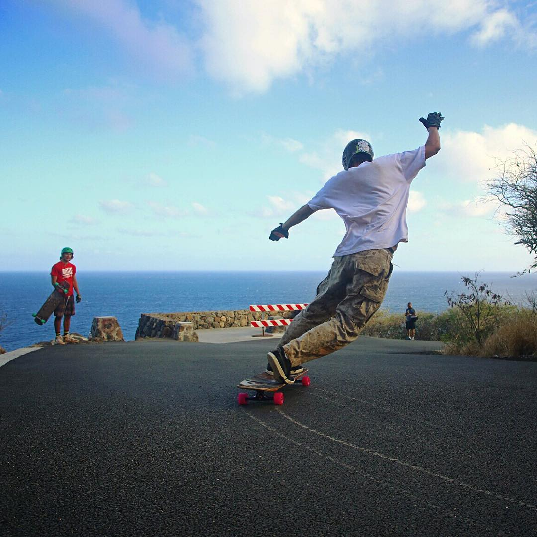 Letting loose Hawaiian style, @rjgoesfast twists it up and keeps himself in check with this toeside slide.