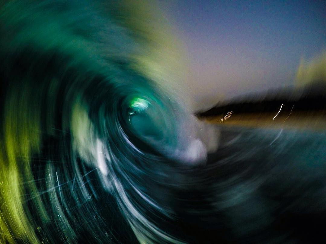 Psychedelic wave taken by @micah_mcsnap during his evening swim on the North Shore of O'ahu.