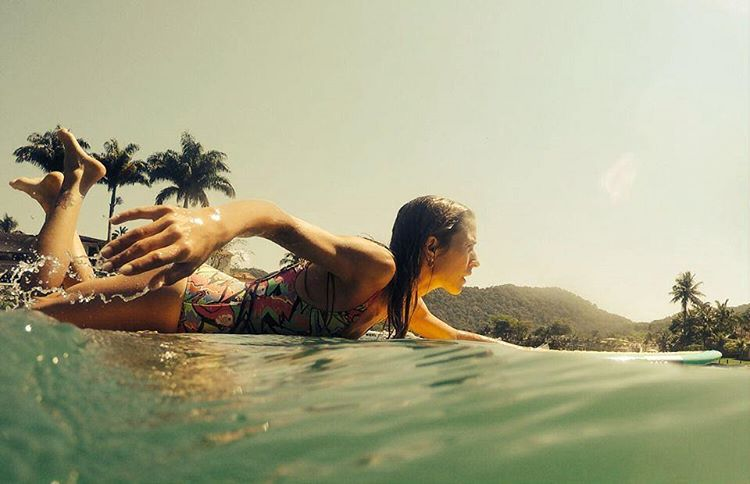 Paddling out in our Parrot Jungle one piece  #Katwai #Swimwear #Surf