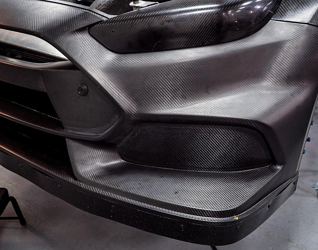 Front corner of the Ford Focus RS RX #2 - aka the car that my teammate @AndreasBakkerud will be piloting in the @FIAWorldRX Championship. This is what a lot of the car looks like with zero vinyl - so much carbon fiber goodness. Awesome. #highfiberdiet...