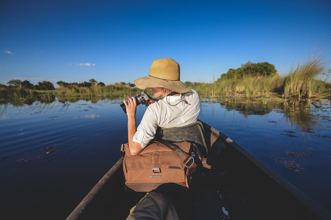 @rneiderman floating through the Okavango Delta in Botswana in a Mokoro, which is the local term for this type of dugout canoe.  #findyourpeak #peakdesign