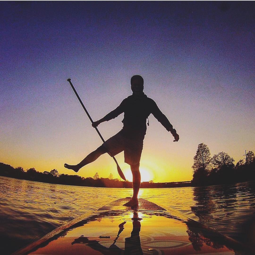 Team rider @bpunz512 with some balance skills out on the water #paddleboard #sup
