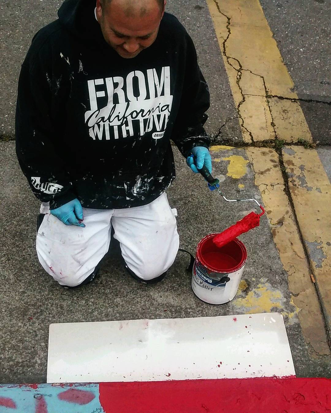 This is our local red curb painter. We love this guy!