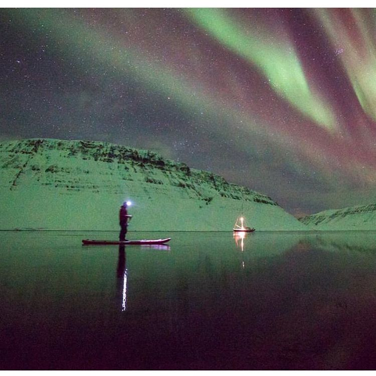 It was calm and crisp evening and thin layer of ice were beginning to form on the fjord. Seals popped their heads up as Jay (coconuts.is) paddled by.  Incredible photo by @auroraarktika on their #halagear boards in #iceland.  #adventuredesigned #isup...