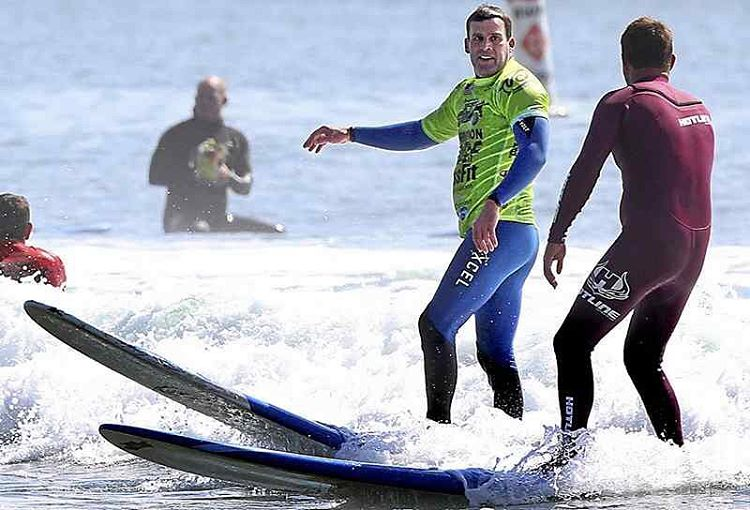 A veteran smiles at his volunteer instructor, Anthony Tashnick, as he grabs a wave at Cowells Wednesday morning. (Shmuel Thaler -- Santa Cruz Sentinel)  #Veterans #Surfing #SantaCruz...