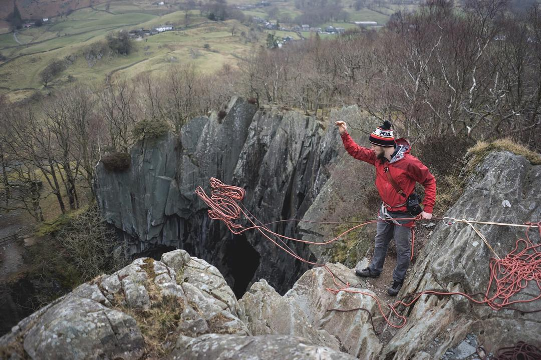 @liamlonsdale tossing the line out over the lip of a 50m deep quarry in the UK Lake District. That was a fun day.  #peakdesign #findyourpeak . . . #lakedistrict #quarry #abseiling