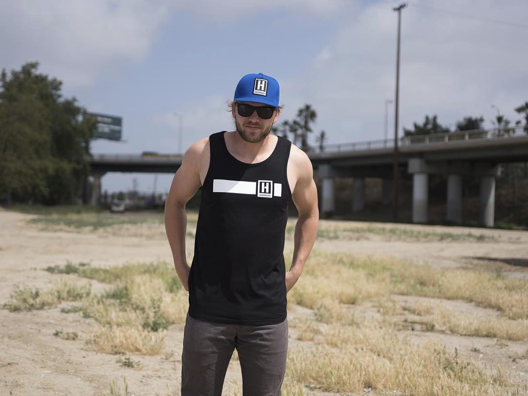 When @bobbyrunyanjr isn't thrashing on his Prolite truck, he's probably lifting things up and then putting them down, right where they started. So we made him show off our new Icon Stripe tank. Available now on #hooniganDOTcom. #doyouevenliftbro