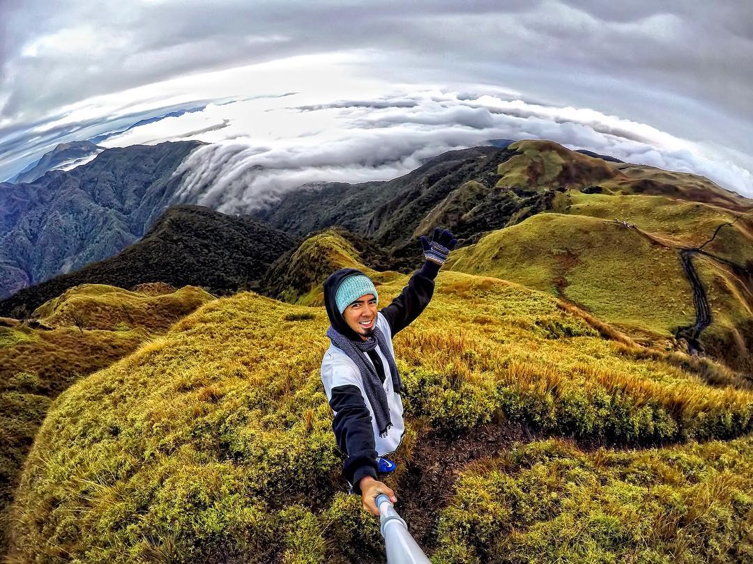 Happy Earth Day! @zion.adventure watches as the clouds roll in over Mount Pulag. GoPro HERO4 | GoPole Reach #gopro #gopole #gopolereach #earthday #