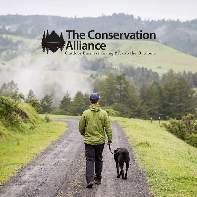 How are we celebrating Earth Day? Secondly, we have joined the @conservationalliance, an org that helps outdoor brands support conservational nonprofits.  Pic: @mattybruborg and Boogie stroll down a damp dirt road in Northern California. #peakdesign...