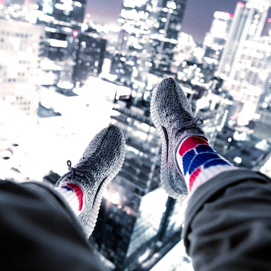 We call this #living on the edge @i.conik #citylights #losangeles #socks #active #grabapair #buildings #athleisure #fashion