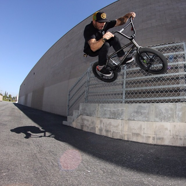 Chain link fence wall ride by BULT team rider @dakroche PC: @maddoghenderson #bulthelmets #bult #bmx