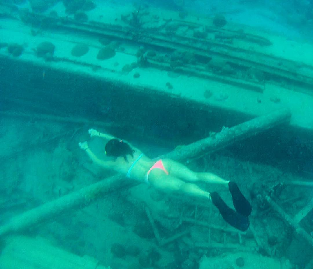 So real it's nearly surreal. Travel writer/surfer/mermaid @alexandracheney free diving a wreck off the coast of #barbados. Go follow her @instagram account for more#odinaadventures! #alexgoestobarbados