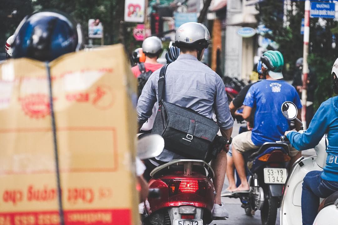 Joey from the Peak Design team hitching a ride through the middle of Ho Chi Minh City. Our design team recently completed a stint there. Looking forward to showing the world what we've been up to! . . . #peakdesign #findyourpeak #theeverydaymessenger...