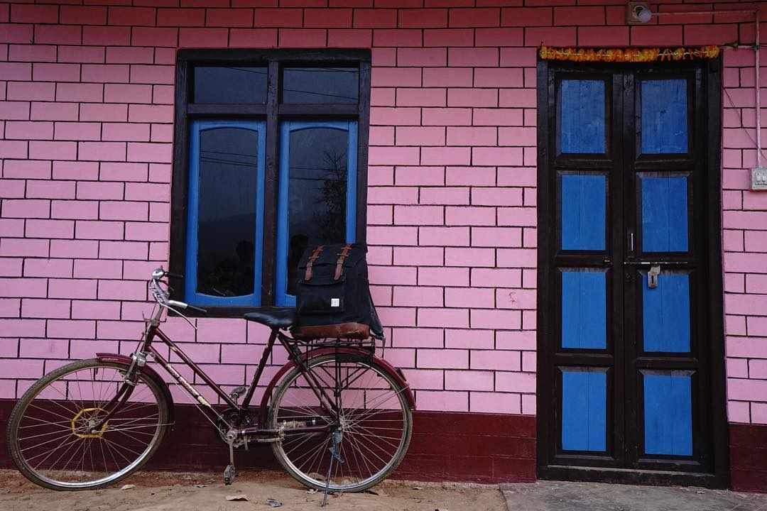 A few seconds after we snapped this, the owner of the house, a heavierset woman in her 40s stormed out confused by the weird foreigners and twenty-some villagers who had gathered around her perfectly painted pink ghar (house). After explaining how we...