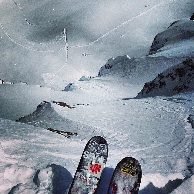Wiley Miller ( @wileymiller ) looking down on this little cherry. Big mountain line into a sweet booter. Futuristic next level stuff here. The skis that take Wiley down this line and others are 40% off right now on 4frnt.com.