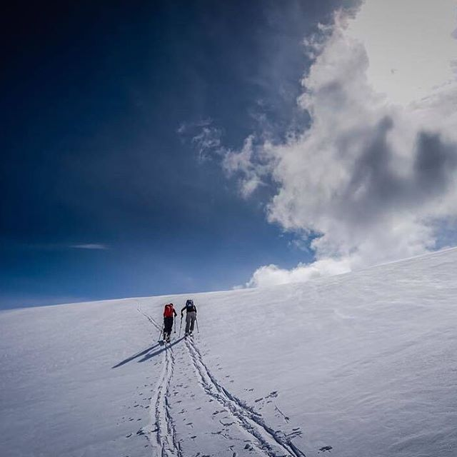 @davidanhalt and @mollystreet making the push to the ridge during a recent heliski trip to the Selkirk Mountains in British Columbia.