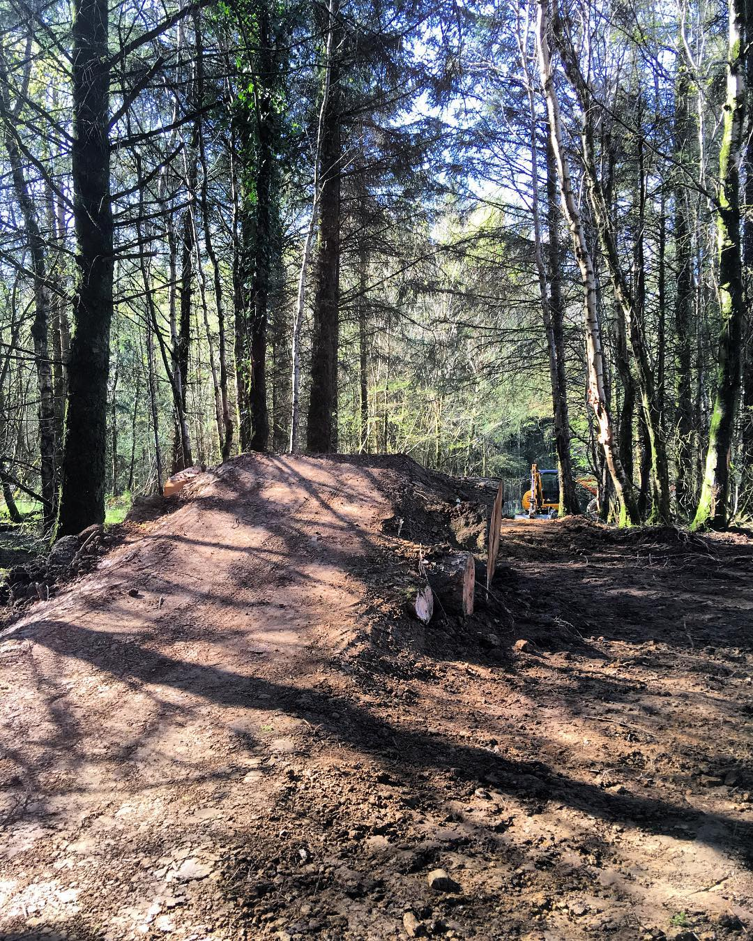 "The final feature on the top section of my brand new mountain bike jump trail....the ""Log Stack"" Ski Jump. Would you send it off this jump? #bikepark #privatebikepark #mtb #santacruz #logjump #build #shredtime #woods #sendit #jumpline #dirt..."
